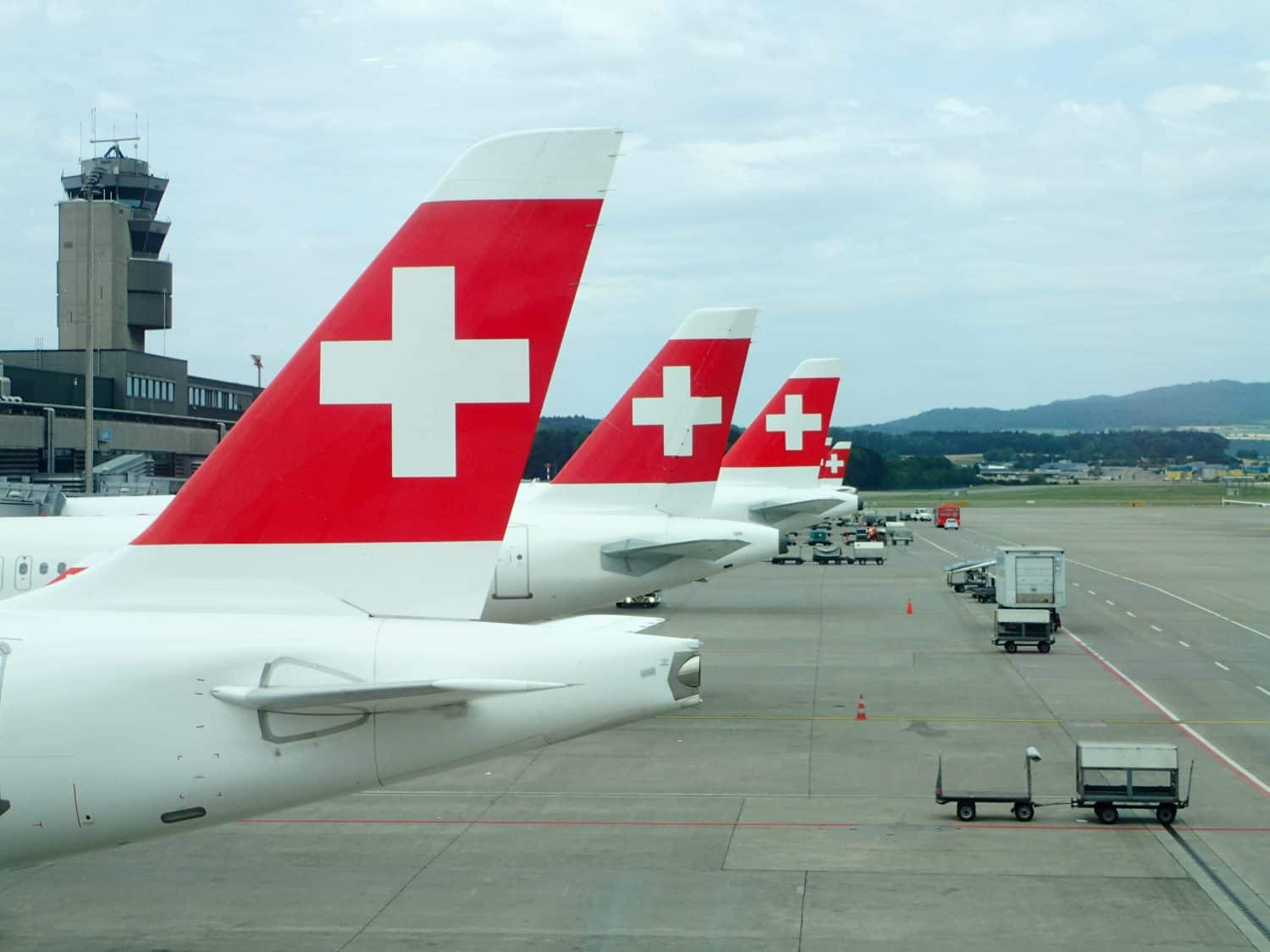 Three tails of Swiss Air planes in a row at New York airport