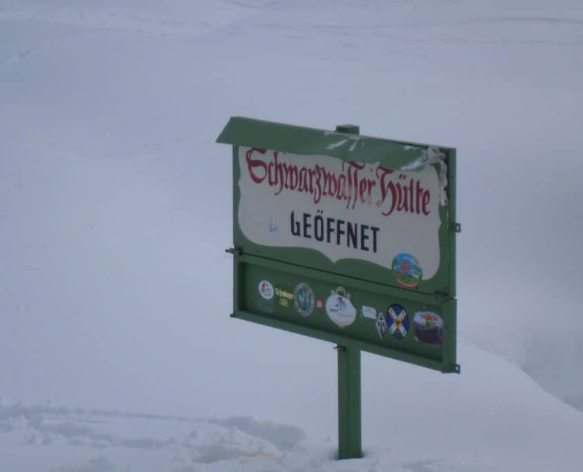 Sign of the Schwarzwasserhut completely in snow