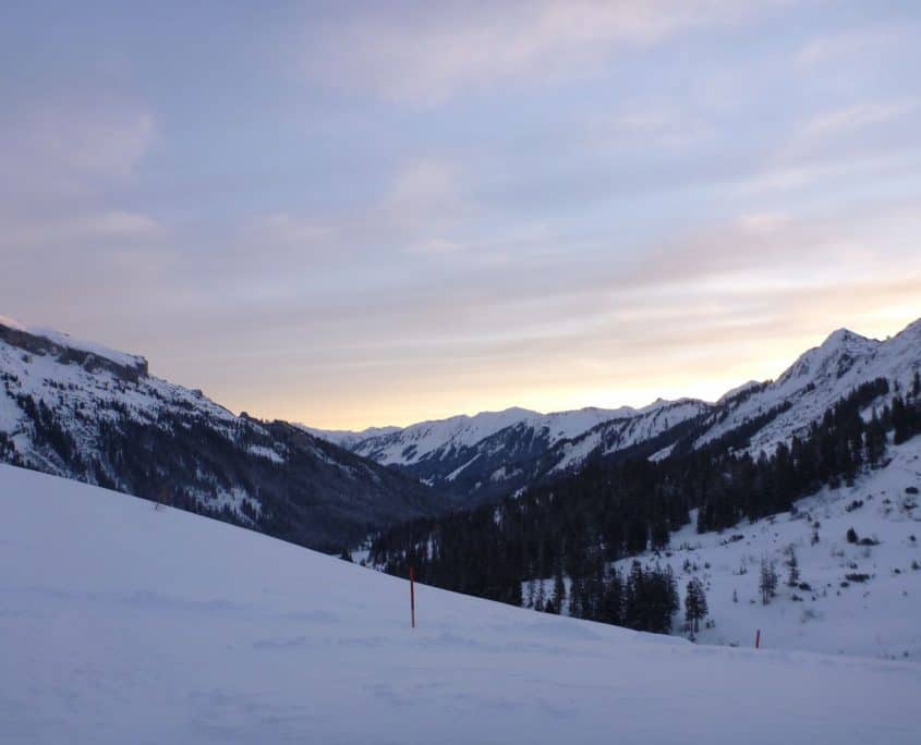 Snowshoeing in the Alps - Sunset watched from the Schwarzwasserhut
