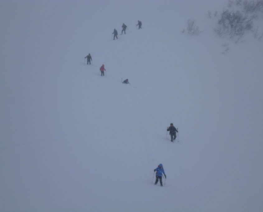 The group hiking out of a whiteout