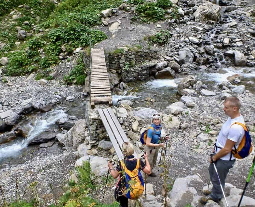 Crossing a small stream on a wooden bridge