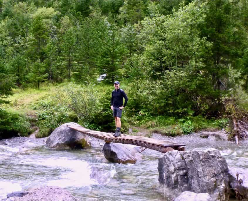 Having fun crosiing a mountain stream