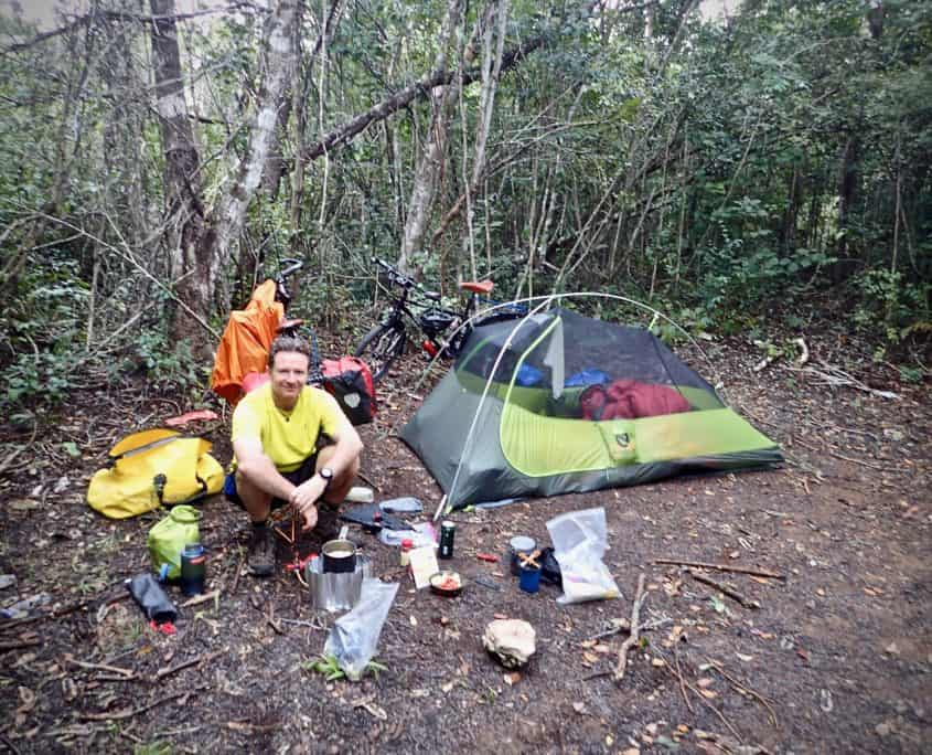 First experiences with bicycle touring - Brad at our second campsite behind some bushes