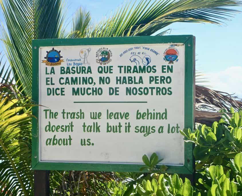 Cycling through Sian Ka'an Biosphere Reserve - sign in Punta Allen