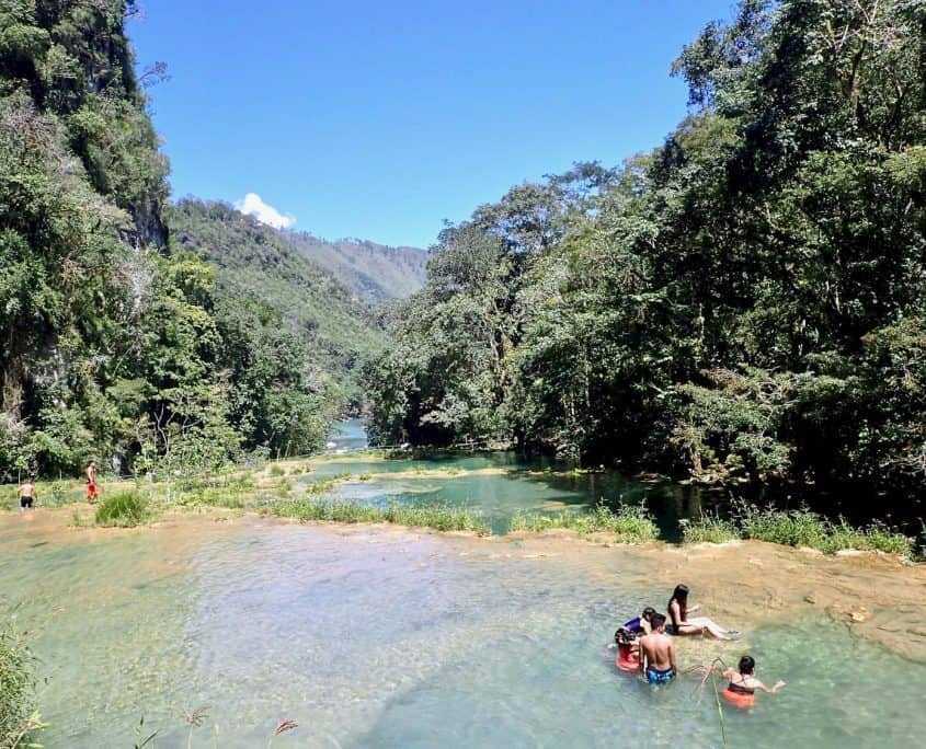People swimming in the limestone pools of Semuc Champey