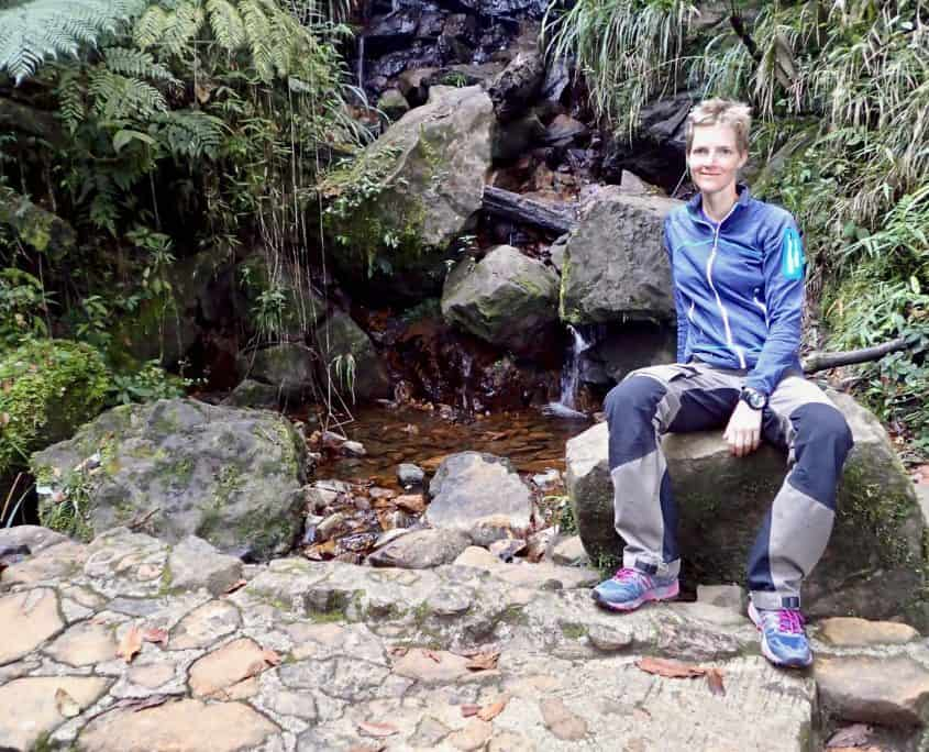 Me sitting next to a small waterfall near our campsite at the Biotopo del Quetzal